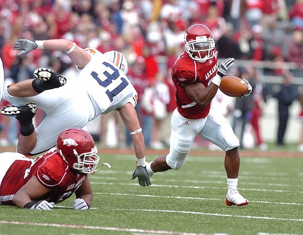 Arkansas tailback Michael Smith runs to the outside against Auburn in the first half Saturday in Razorback Stadium. Smith had 18 carries for 145 yards and one touchdown in the Hogs' 44-23 victory.