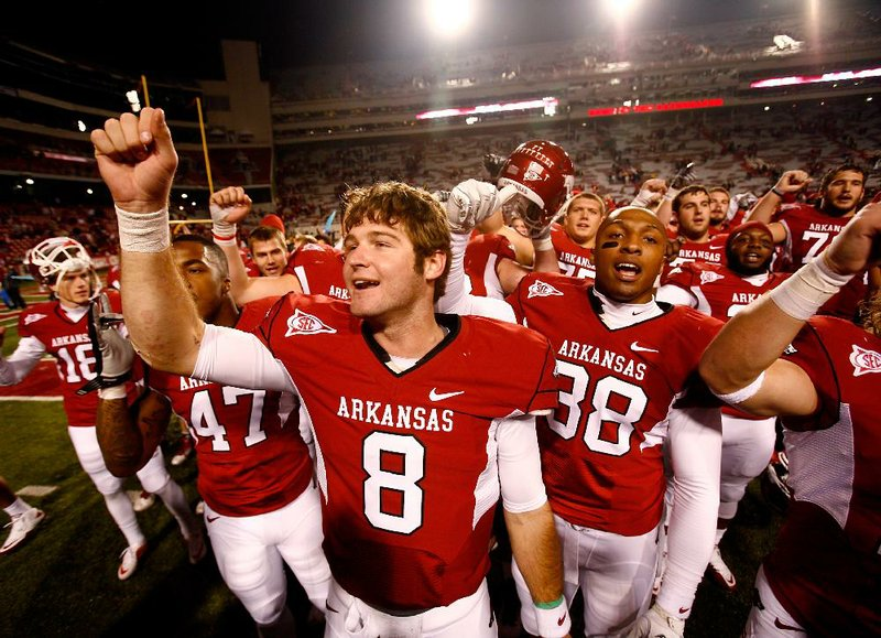 """""""Who doesn't want to play on a top-10 stage with something to prove?"""" Arkansas quarterback Tyler Wilson asked. Wilson is seen here with his teammates singing the fight song."""