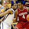 Arkansas forward Devonta Abron (4) works the ball against LSU's Storm Warren during Saturday's game at Pete Maravich Assembly Center in Baton Rouge.
