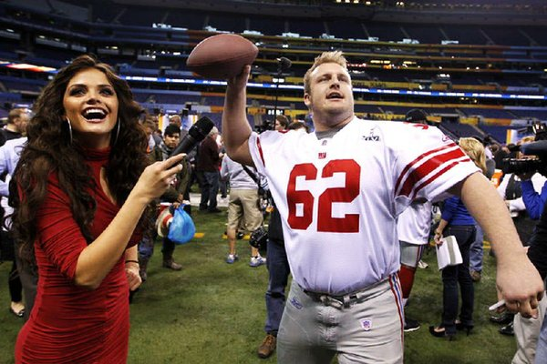 FILE — New York Giants offensive guard Mitch Petrus, a former Razorback, throws during Media Day for NFL football's Super Bowl XLVI Tuesday, Jan. 31, 2012, in Indianapolis. (AP Photo/Michael Conroy)