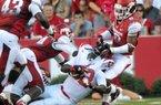 Arkansas defensive back Tevin Mitchel pulls down Jacksonville State running back DaMarcus James on Saturday night.