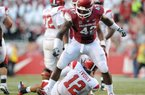 Arkansas defensive end Chris Smith was named SEC co-defensive lineman of the week with two pass breakups and two quarterback hurries in the Razorbacks' 19-15 victory over Tulsa on Saturday.