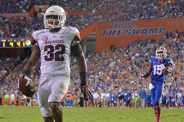 Arkansas running back Jonathan Williams runs for a touchdown in the first quarter of a Saturday, Oct. 5, 2013 game against Florida at Ben Hill Griffin Stadium in Gainesville, Fla.