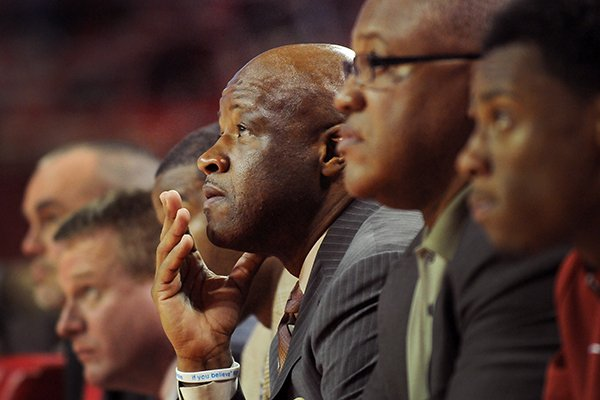 Arkansas coach Mike Anderson watches as his Razorbacks defeat UT Martin during the second half of the basketball game in Bud Walton Arena in Fayetteville on Thursday December 19, 2013.
