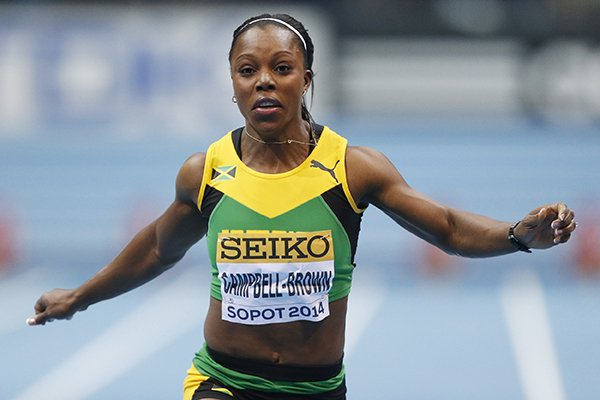 In this file photo dated Saturday, March 8, 2014, Jamaica's Veronica Campbell-Brown runs in the 60m heats during the Athletics World Indoor Championships in Sopot, Poland. (AP Photo/Petr David Josek, FILE)