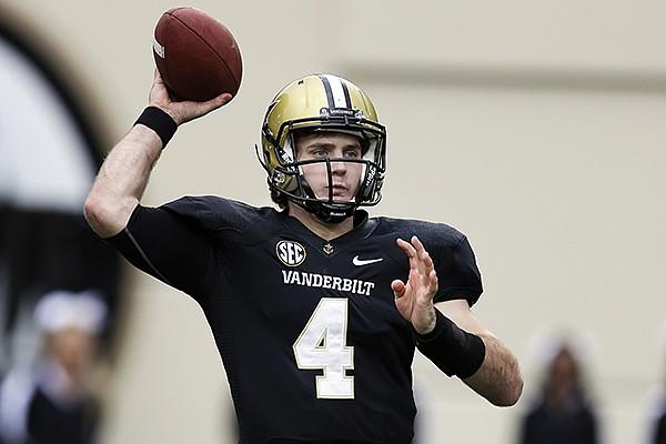 In this Oct. 19, 2013, file photo, Vanderbilt quarterback Patton Robinette passes against Georgia in an NCAA college football game in Nashville, Tenn. (AP Photo/Mark Humphrey, File)