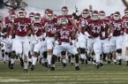 Arkansas players run on to the field prior to a game against Northern Illinois on Saturday, Sept. 20, 2014 at Razorback Stadium in Fayetteville.