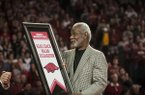 Former Arkansas head coach Nolan Richardson accepts a replica of his banner unveiled Tuesday, Feb. 24, 2015, at Bud Walton Arena in Fayetteville.
