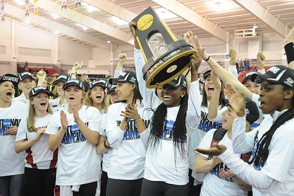 Arkansas athletes celebrate Saturday, March 14, 2015, after the Arkansas women's team won the NCAA Indoor Track and Field Championship at the Randal Tyson Track Center in Fayetteville.