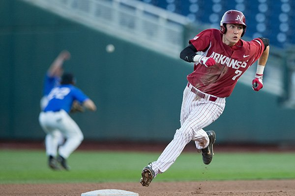 Arkansas' Bobby Wernes rounds the bases after hitting a triple in the sixth inning of a game against Creighton on Tuesday, May 12, 2015, at TD Ameritrade Park in Omaha, Neb. (Mark Davis/Omaha World-Herald)