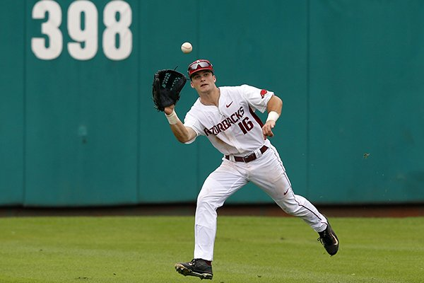 Arkansas outfielder Andrew Benintendi reaches up to grab a fly out by Oral Roberts's Anthony Sequeira in the third inning of a game at the Stillwater Regional of the NCAA college baseball tournament in Stillwater, Okla., Friday, May 29, 2015. (AP Photo/Sue Ogrocki)