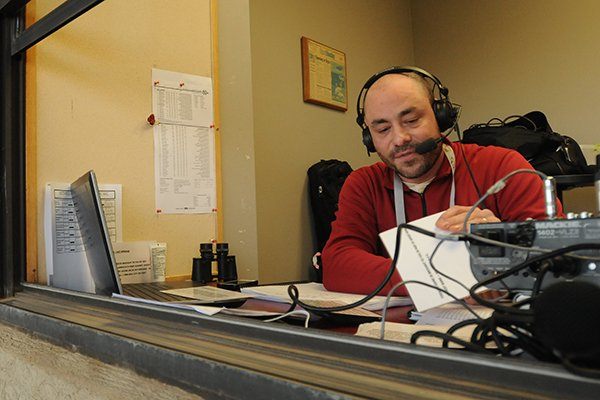 Arkansas play-by-play announcer Phil Elson prepares prior to a game against North Dakota on Friday, Feb. 13, 2015, at Baum Stadium in Fayetteville.