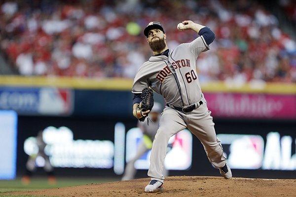 American League's Dallas Keuchel, of the Houston Astros, throws during the first inning of the MLB All-Star baseball game, Tuesday, July 14, 2015, in Cincinnati. (AP Photo/Jeff Roberson)