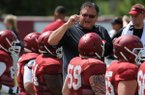 Arkansas offensive line coach Sam Pittman speaks Tuesday, Aug. 11, 2015, to members of his offensive line during practice at the university's practice field in Fayetteville.