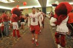 Arkansas quarterback Austin Allen and the rest of the Razorbacks enter the room Friday, Aug. 28, 2015, during the annual Razorback Kickoff dinner at the Northwest Arkansas Convention Center in Springdale.