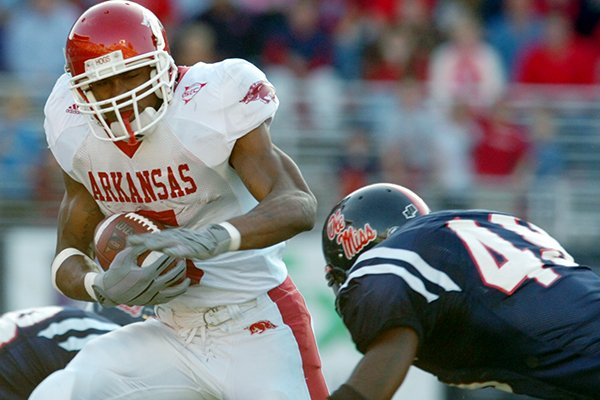 Arkansas running back Darren McFadden is tackled by Ole Miss linebacker Patrick Willis during a game Saturday, Nov. 12, 2005, in Oxford, Miss.