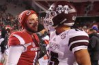 Arkansas' Brandon Allen chats with Mississippi State's Dak Prescott after their game Saturday, Nov. 21, 2015, in Fayetteville.
