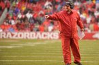 Arkansas coach Bret Bielema instructs players during a game against Missouri on Friday, Nov. 27, 2015, at Razorback Stadium in Fayetteville.