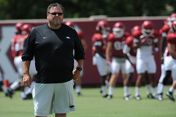 Arkansas assistant coach Sam Pittman watches Saturday, Aug. 8, 2015. during practice at the university football practice field in Fayetteville.