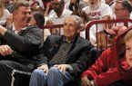 Former Arkansas basketball coach Eddie Sutton, center, talks with former players Joe Kleine, left, and Darrel Walker, right, during a game between Arkansas and Kentucky on Thursday, Jan. 21, 2016, at Bud Walton Arena in Fayetteville.