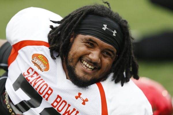 Arkansas offensive guard Sebastian Tretola smiles during stretching at the NCAA college football practice for the Senior Bowl, Wednesday, Jan. 27, 2016, at Ladd–Peebles Stadium, in Mobile, Ala. (AP Photo/Brynn Anderson)