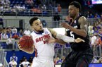Florida guard Chris Chiozza (11) is fouled while driving to the basket by Arkansas guard Anthlon Bell (5) during the second half of an NCAA college basketball game at the O'Connell Center on Wednesday, Feb. 3, 2016 in Gainesville, Fla. Florida defeated Arkansas 87-83. (Matt Stamey/The Gainesville Sun via AP)