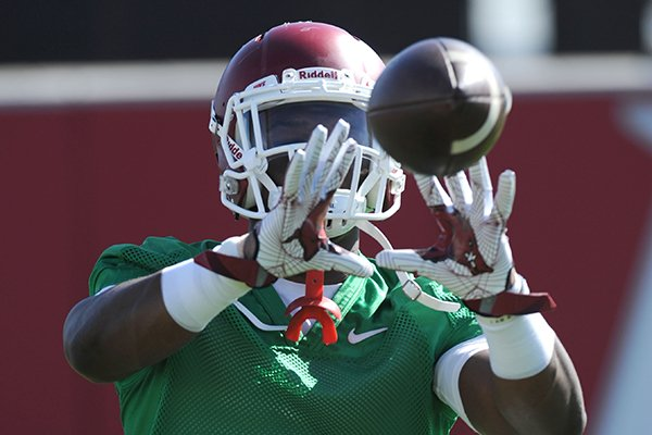 Arkansas running back Rawleigh Williams III catches a pass Tuesday, March 29, 2016, during practice at the university's practice field on campus in Fayetteville.