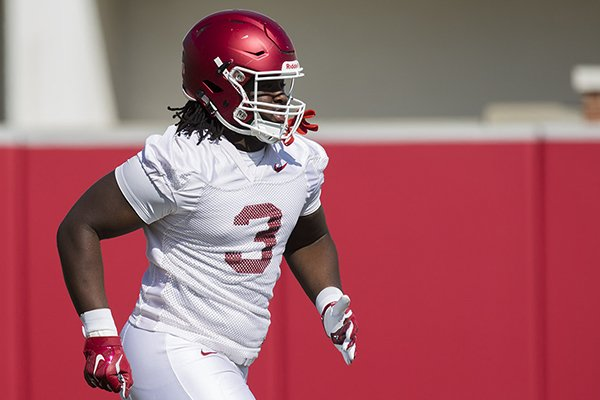 Arkansas defensive lineman McTelvin Agim goes through drills during practice Tuesday, March 29, 2016, in Fayetteville.
