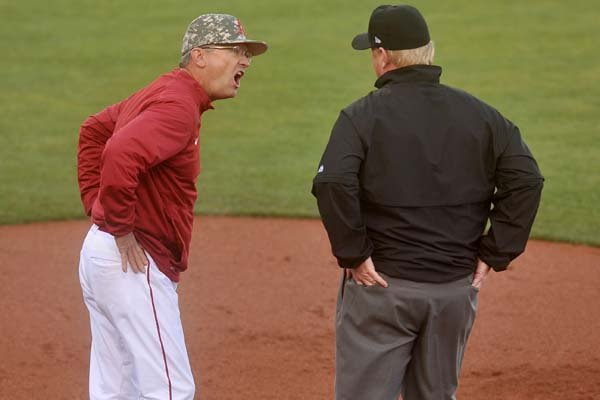 Arkansas coach Dave Van Horn argues a call with first base umpire Darrell Arnold in the first inning against Auburn on Saturday, March 26, 2016, at Baum Stadium in Fayetteville.