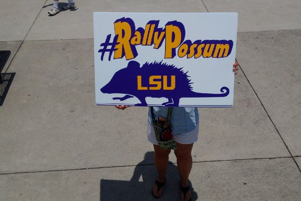 An LSU fan holds up a sign prior to a game against Arkansas on Sunday, May 8, 2016, at Alex Box Stadium in Baton Rouge, La.