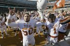 Texas offensive lineman Jake Raulerson celebrates a December win on the road against Baylor with his former Longhorns teammates. On Thursday, Raulerson announced he will become a Razorback. (LM Otero/The Associated Press)