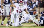 Arkansas defensive lineman Deatrich Wise gets up after sacking Ole Miss quarterback Chad Kelly on Saturday, Nov. 7, 2015, late in the fourth quarter at Vaught-Hemingway Stadium in Oxford, Miss.