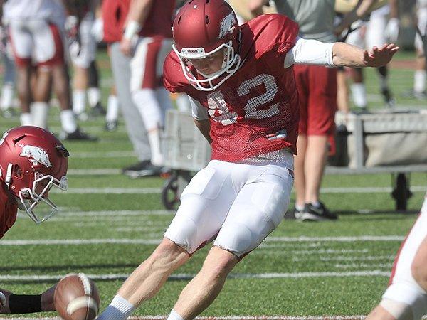 Arkansas kicker Lane Saling goes through drills Saturday, April 15, 2015, at Razorback Stadium in Fayetteville.