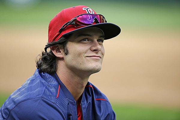 Boston Red Sox outfielder Andrew Benintendi looks around Safeco Field as he warms up before batting practice prior to the team's baseball game against the Seattle Mariners, Tuesday, Aug. 2, 2016, in Seattle. (AP Photo/Ted S. Warren)