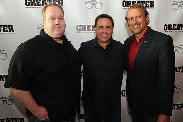 """Director David Hunt (from left) poses Tuesday, Aug. 23, 2016, with producer Brian Reindl, and Marty Burlsworth, brother of Brandon Burlsworth, during a red carpet event ahead of the premiere of the movie """"Greater"""" at the Malco Razorback Cinema 16 in Fayetteville."""