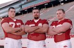 From left to right, Brandon Burlsworth, Grant Garrett and Russ Brown pose for a picture in 1997.