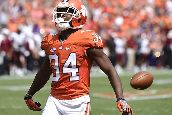 FILE- In this Saturday, Sept. 10, 2016, file photo, Clemson wide receiver Ray-Ray McCloud drops the football short of the goal line during the first half of an NCAA college football game against Troy in Clemson, S.C. A few college football players took the nonchalant approach to entering the end zone too far in the last couple weekends, casually dropping the ball right before crossing the goal line. With goal-line brain freezes seemingly spreading, some coaches are taking action keep this case of the dropsies from becoming an outbreak. (AP Photo/Rainier Ehrhardt, File)