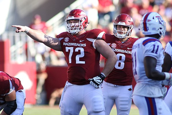 Arkansas' Frank Ragnow (72) yells out to his teammates before getting set during the fourth quarter of an NCAA college football game against Louisiana Tech Saturday, Sept. 3, 2016 in Fayetteville, Ark. Arkansas beat Louisiana Tech, 21-20. (AP Photo/Samantha Baker)