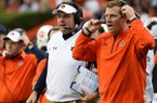 In this Nov. 21, 2015, file photo, Auburn coach Gus Malzahn, left, and offensive coordinator Rhett Lashlee, right, watch the action against Idaho during the first half of an NCAA football game in Auburn, Ala. Malzahn, who built his career on offensive play calling and creativity, has finally handed over the reins to let offensive coordinator Rhett Lashlee call plays. (AP Photo/Mark Almond, File)