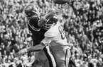Arkansas left end Bruce James, right, forces Archie Manning of Ole Miss to get off a bad pass after a chase through the Rebels' backfield in Sugar Bowl game in New Orleans, Thursday, Jan. 1, 1970. The short pass was intercepted by Arkansas. Ole Miss led through most of the game. (AP Photo)