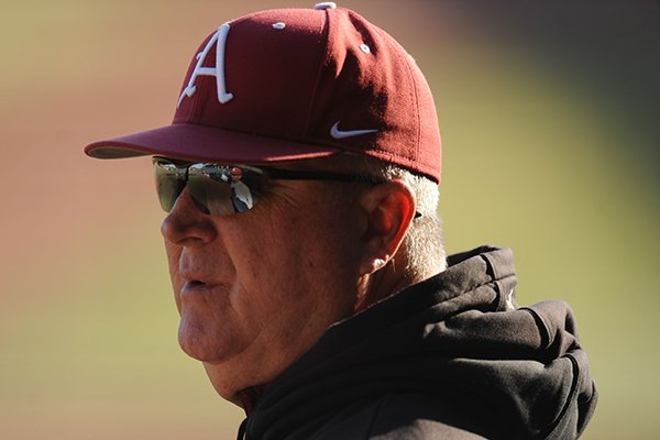 Arkansas pitching coach Dave Jorn watches during practice Friday, Jan. 23, 2015, at Baum Stadium in Fayetteville.