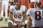 Arkansas running back Rawleigh Williams watches the final seconds of the Razorbacks' 35-24 loss to Virginia Tech in the Belk Bowl on Thursday, Dec. 29, 2016, in Charlotte, N.C.