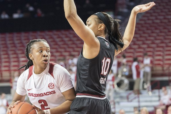 Arkansas' Aaliyah Wilson looks for help while South Carolina's Allisha Gray defends Sunday Feb. 5, 2017 at Bud Walton Arena in Fayetteville. South Carolina won 79-49.
