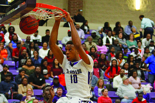 El Dorado's Daniel Gafford throws down a two-hand dunk against Texarkana on Saturday, Feb. 26, 2017, at Wildcat Arena in El Dorado. The Wildcats beat the Razorbacks 91-78 as Gafford totaled 34 points and 26 rebounds.