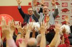 NWA Democrat-Gazette/ANDY SHUPE Newly hired Arkansas women's basketball coach Mike Neighbors (right) leads the room Tuesday, April 4, 2017, in a Hog call alongside Jeff Long, director of athletics, during a ceremony and press conference to announce his hire at the university's basketball practice facility. Visit nwadg.com/photos to see more photographs from the event.