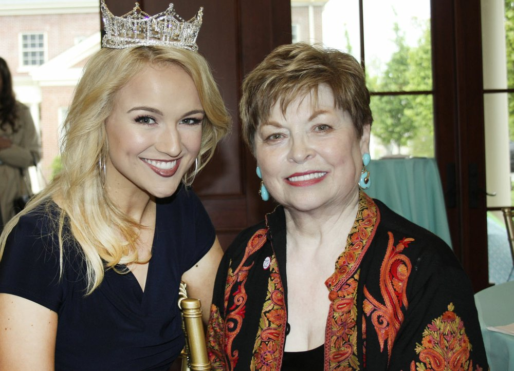 NWA Democrat-Gazette/CARIN SCHOPPMEYER Savvy Shields, Miss America (left), visits with Donna Axum Whitworth, Miss America 1964 and a founding member of the University Women's Giving Circle, at a reception in Axum Whitworth's honor April 20 at the Fowler House Conservatory on the UA campus in Fayetteville.