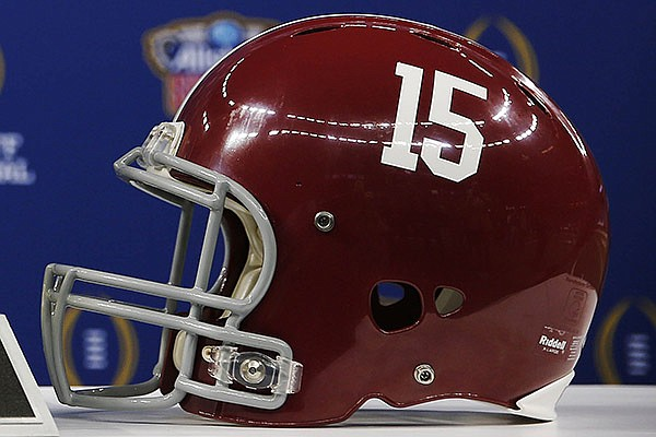 An Alabama helmet is displayed at the Mercedes-Benz Superdome in New Orleans, Tuesday, Dec. 30, 2014. (AP Photo/Brynn Anderson)