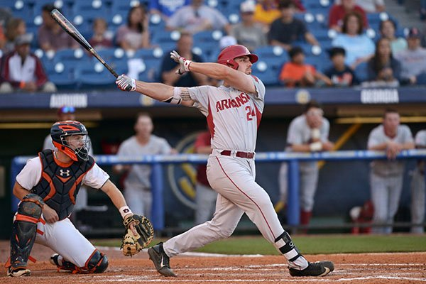 Arkansas first baseman Chad Spanberger hits a home run during a game against Auburn on Thursday, May 25, 2017, at the SEC Tournament in Hoover, Ala.