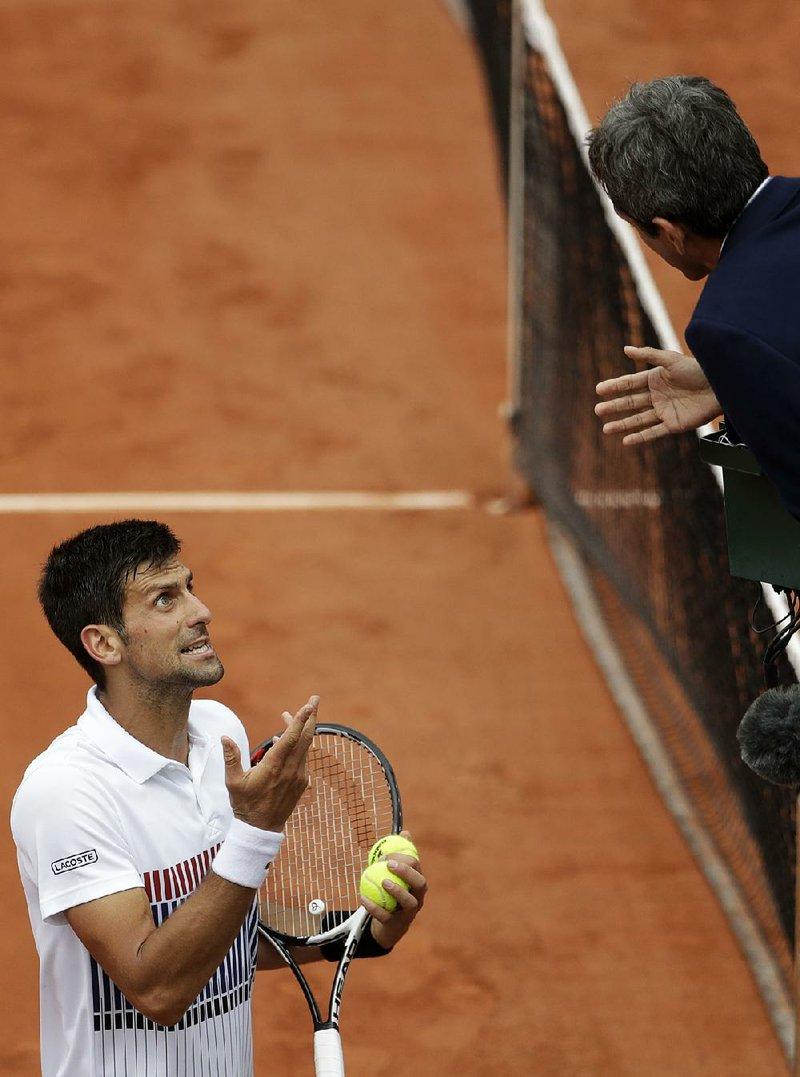 Djokovic Fights Way To Advance