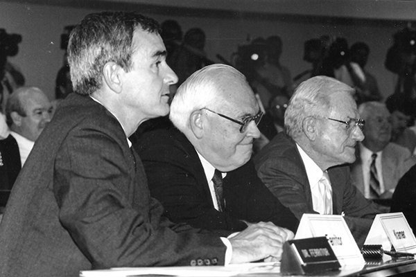 Arkansas chancellor Dan Ferritor, SEC commissioner Roy Kramer and Arkansas athletics director Frank Broyles listen during a University of Arkansas Board of Trustees meeting on Aug. 1, 1990, at which the Razorbacks were invited to join the SEC.